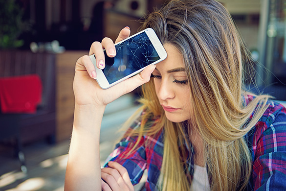depressed teen with her phone