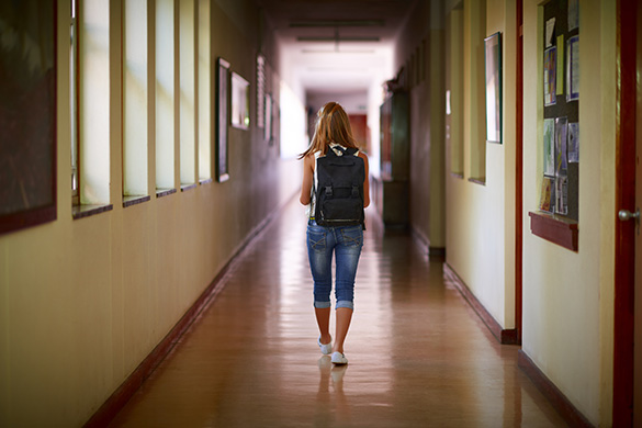 student walking down the hall