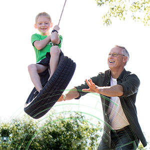 man and child tire swing - ortho event