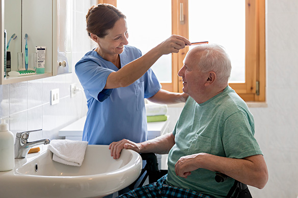 home health worker assisting patient