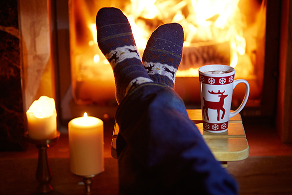 feet by the fire with hot cocoa
