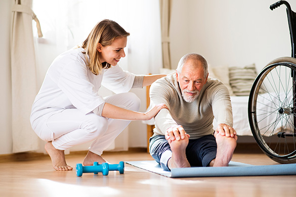 man getting physical therapy in home