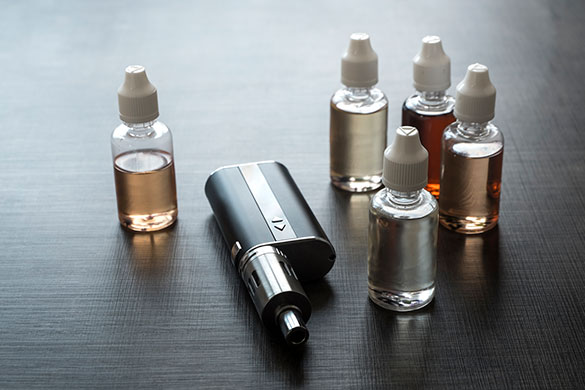 e-cigarette and bottles of liquid nicotine