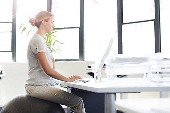 woman with good posture sitting at a desk