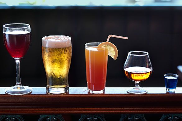 variety of alcoholic drinks in glasses