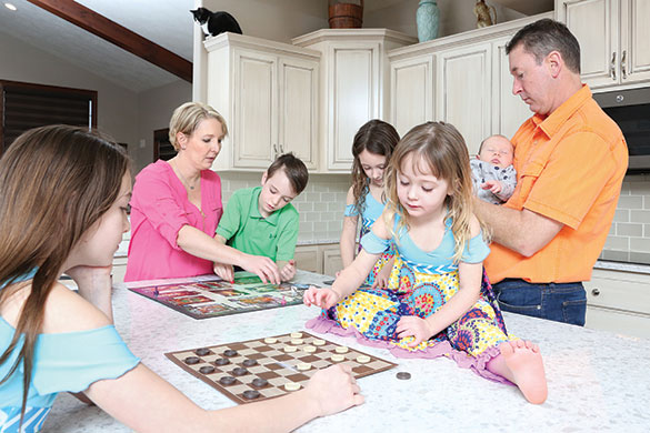 tricia and jon merrigan in the kitchen with their children