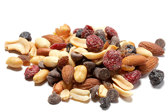 trail mix in a bowl on a wooden table