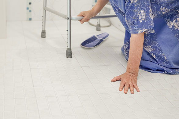 lower view of elderly woman falling in bathroom