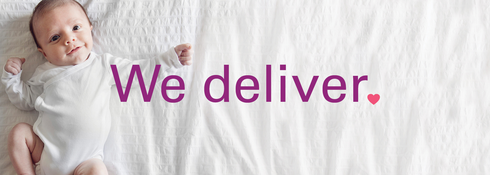 We deliver. Smiling baby looking at camera.