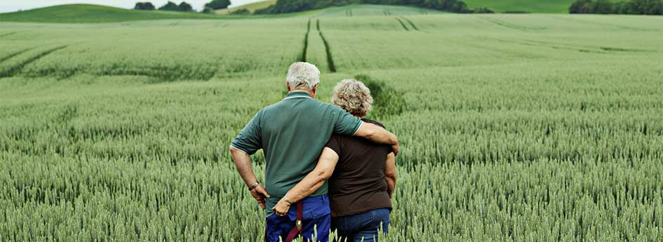Couple Standing in Field