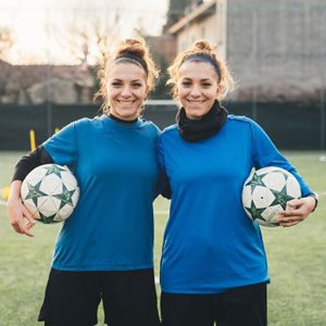 Adult Twin Girls with Soccer Gear
