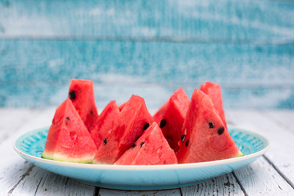 slices of watermelon on a blue plate
