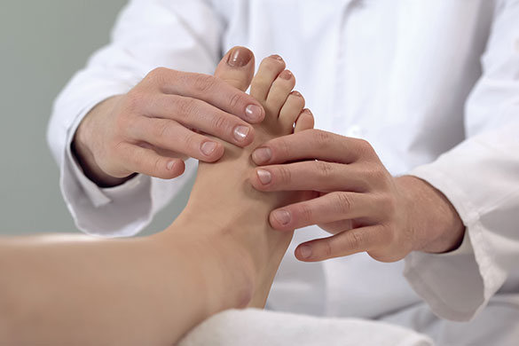 closeup of doctor examining patients foot