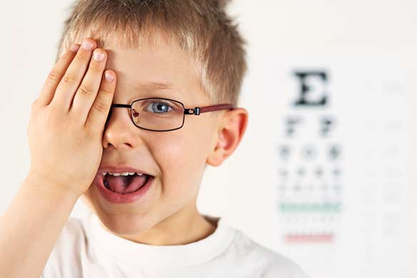 boy with glasses covering eye