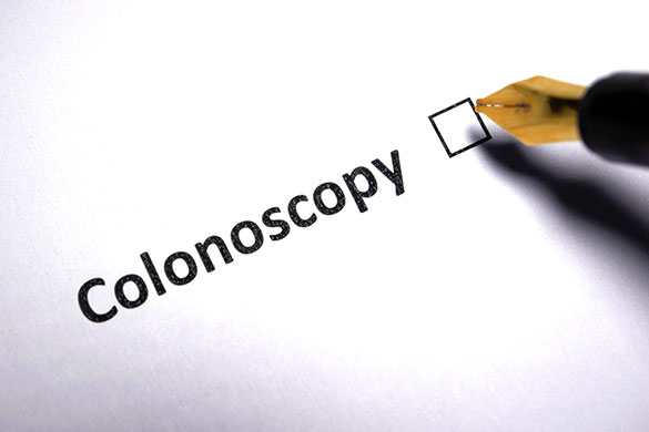 the word colonoscopy on paper with check box and pen