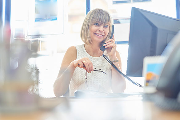 happy businesswoman talking on phone