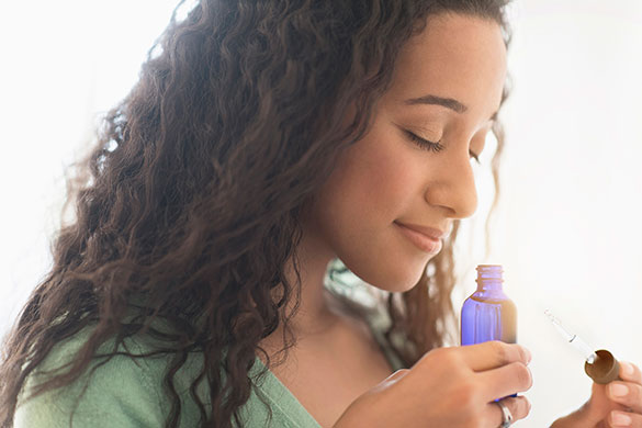 closeup of woman smelling essential oil