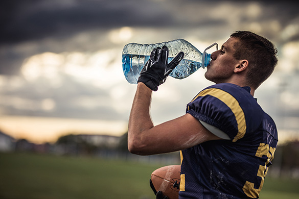 football player drinking water
