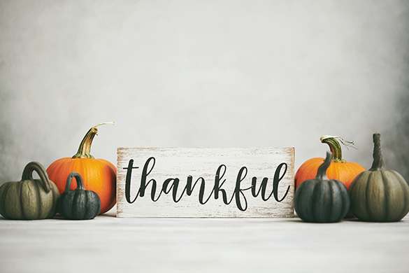 variety of pumpkins and thankful sign