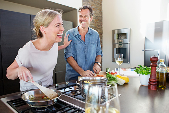 couple cooking and laughing together